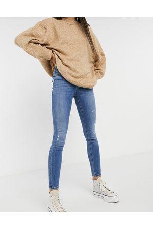 Vero Moda Women Skinny - Sophia high rise skinny jean with distressing in medium