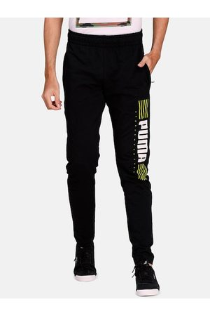 PUMA Men Black Solid Slim Fit Sports 1948 Pants