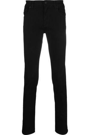 Dolce & Gabbana Men Skinny - Logo-embossed skinny jeans