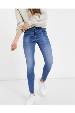 River Island High rise skinny jeans in mid