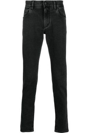 Dolce & Gabbana Men Slim - Logo embossed slim-fit jeans