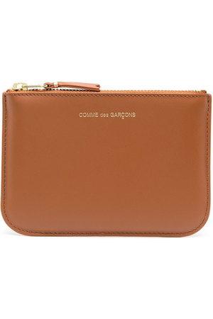 Comme des Garçons Wallets - Ruby Eye zipped wallet