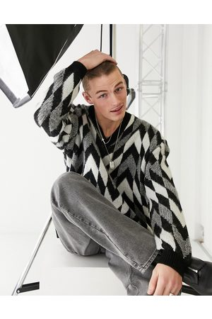 ASOS Knitted oversized v-neck jumper with monochrome checkerboard
