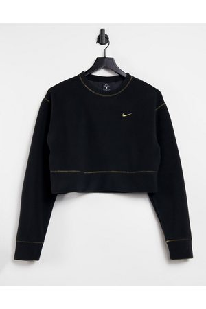 Nike Icon Clash sweatshirt in and gold