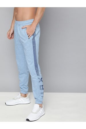 HRX Men Blue Solid Running Joggers with Printed Detailing