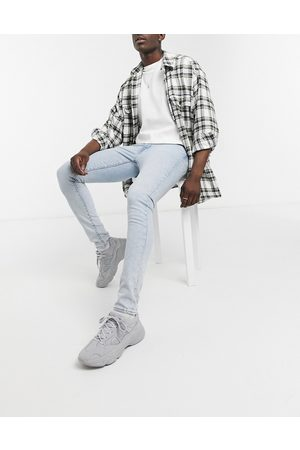 Levi's Levi's Youth 519 super skinny fit hi ball distressed jeans in wolf punk advance mid wash