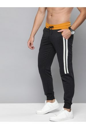 HERE&NOW Men Charcoal Grey Solid Joggers with Striped Detail