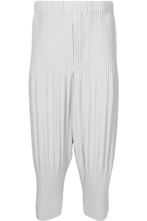 HOMME PLISSÉ ISSEY MIYAKE Pleated tapered trousers