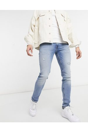 Jack & Jones Intelligence Liam skinny jeans with rips in light