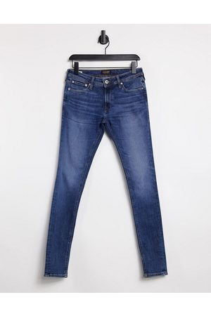 Jack & Jones Intelligence Tom spray on jeans in mid