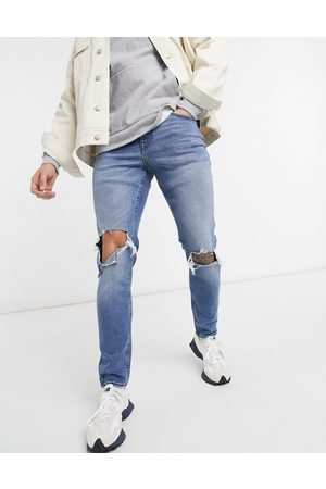 New Look Skinny jeans with knee rips in mid