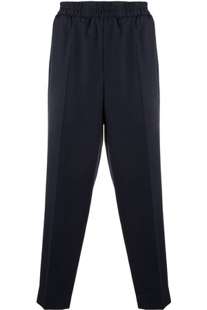 Etudes Men Trousers - Pressed-crease elasticated-waist trousers