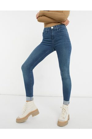 River Island Molly turnup skinny jeans in mid tint