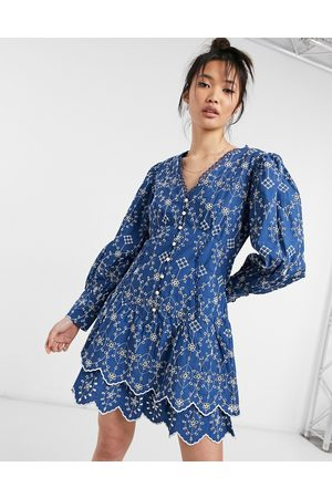 River Island Embroidered volume sleeve mini shirt dress in navy