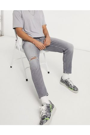 River Island Tapered jeans with rips in
