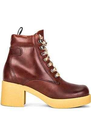 Miu Miu Platform Lace Up Ankle Boots in Cognac