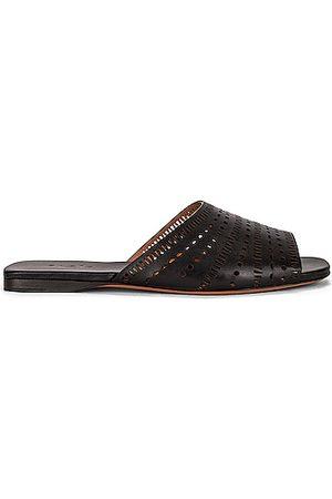 Alaïa Vienne Leather Slides in Noir
