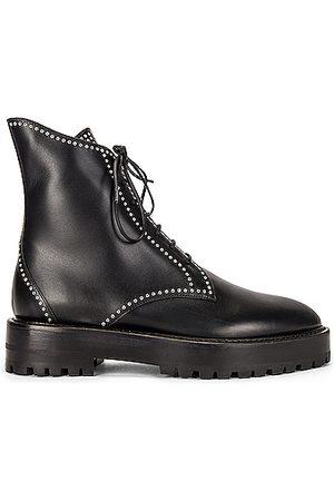 Alaïa Leather Micro Oeillets Boots in Noir