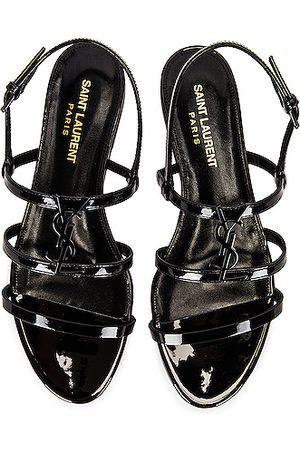 Saint Laurent Cassandra Flat Sandals in Noir