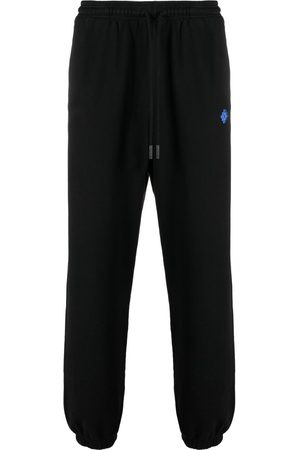 MARCELO BURLON Men Trousers - Geometric-pattern track pants