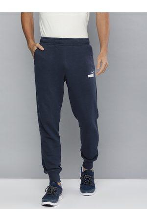 PUMA Men Navy Blue Solid ESS Logo Pants Joggers