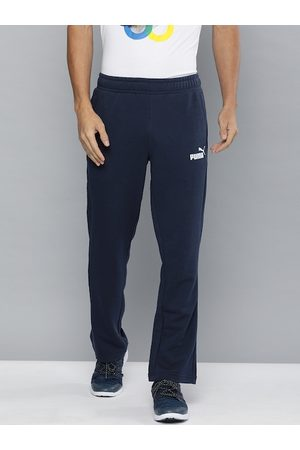 PUMA Men Navy Blue Slim Fit Solid ESS Logo TR op Track Pants