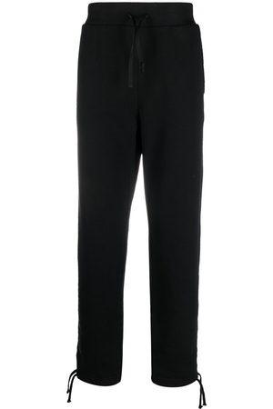 1017 ALYX 9SM Men Trousers - Logo print track trousers