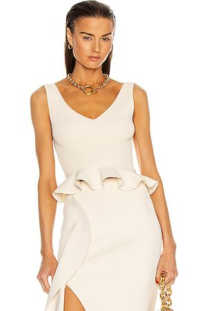 Alexander McQueen Sleeveless Peplum Top in Ivory
