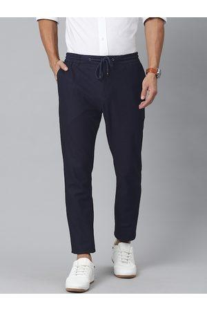 Tommy Hilfiger Men Navy Blue Slim Fit Solid Regular Trousers