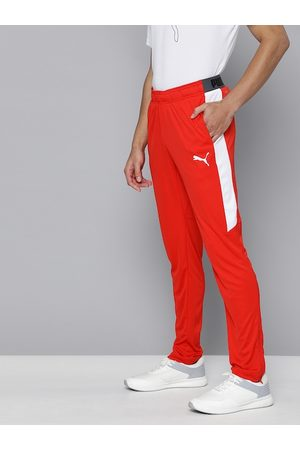 PUMA Men Red Solid Slim Fit Drycell Speed Track Pants with Side Stripe