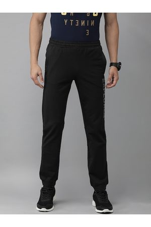 Wildcraft Men Black Solid Joggers with Printed Detail