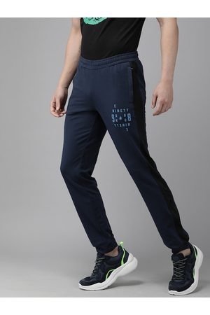 Wildcraft Men Navy Blue Side Striped with Print Off Active Track 9 Slim Fit Joggers