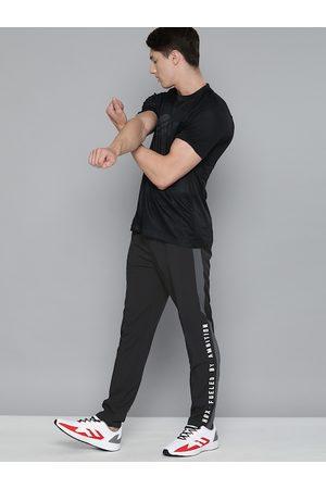 HRX Men Black & Grey Colorblock Slim Fit Antimicrobial Track Pants