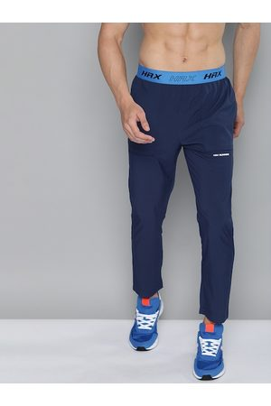 HRX Men Blue Solid Slim Fit Rapid-Dry Antimicrobial Running Track Pants