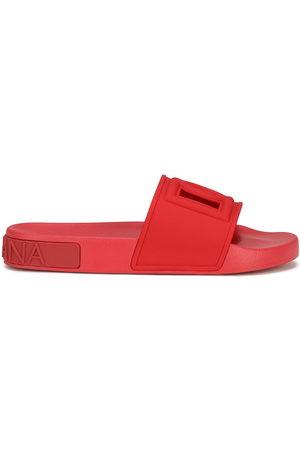 Dolce & Gabbana Women Sandals - Logo-embossed slides