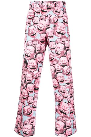 Comme des Garçons Men Trousers - All-over face print trousers