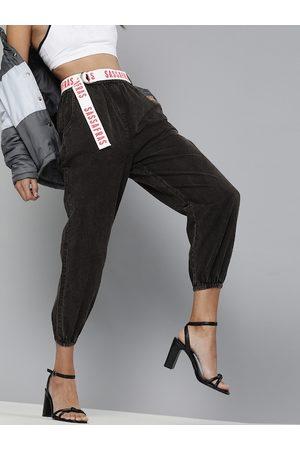 Sassafras Women Black Regular Fit Solid Cropped Denim Joggers