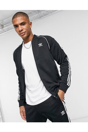 adidas Adicolor three stripe track jacket in