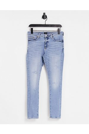 River Island Super skinny jeans in mid