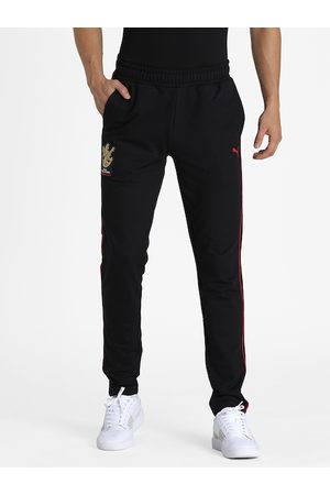 PUMA Men Black Solid Slim Fit Knitted RCB Fanwear Track Pant