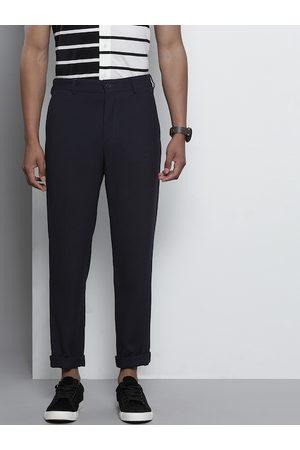 Tommy Hilfiger Men Navy Blue Slim Fit Self Design Regular Trousers