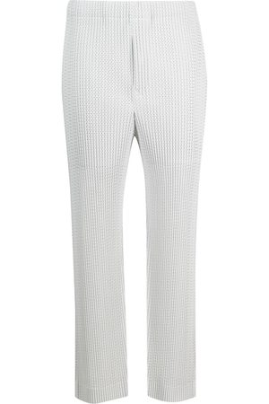 HOMME PLISSÉ ISSEY MIYAKE Knitted slim-fit trousers