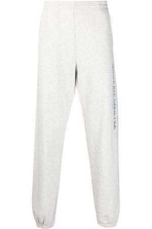 Sporty & Rich Men Trousers - Logo-print cotton track pants
