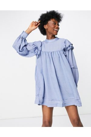 In The Style X Lorna Luxe ruffle shoulder puff sleeve smock dress in textured blue stripe
