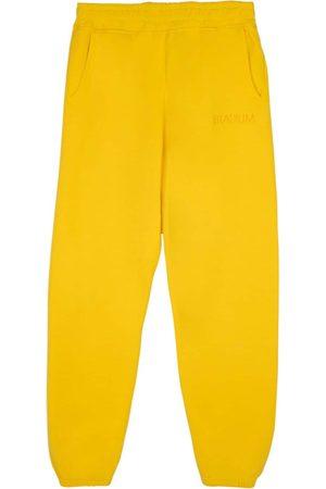"Stadium Goods Trousers - Eco track pants ""Sunshine"""