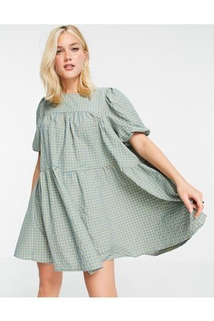 In The Style X Olivia Bowen puff sleeve tiered smock dress in check print