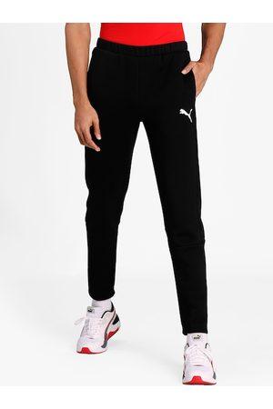 PUMA Men Slim Trousers - Men Black Solid Slim-Fit Track Pants