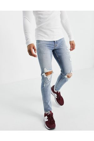 New Look Skinny jeans with rips in light wash
