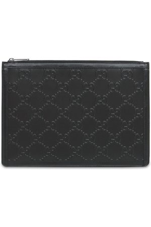 Gucci Gg Embossed Leather Pouch