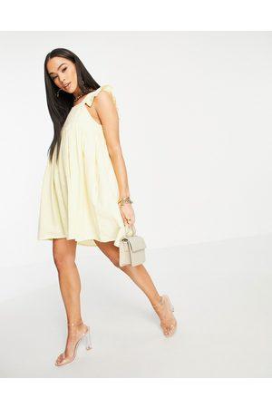 In The Style X Stacey Solomon flutter sleeve mini smock dress in lemon